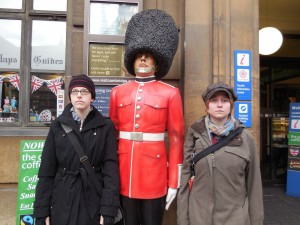 Colleen and Cheryl pose with a Palace Guard statue