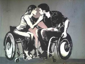 A charcoal-like picture of a young woman and young man, both in wheelchairs lean in to kiss eachother